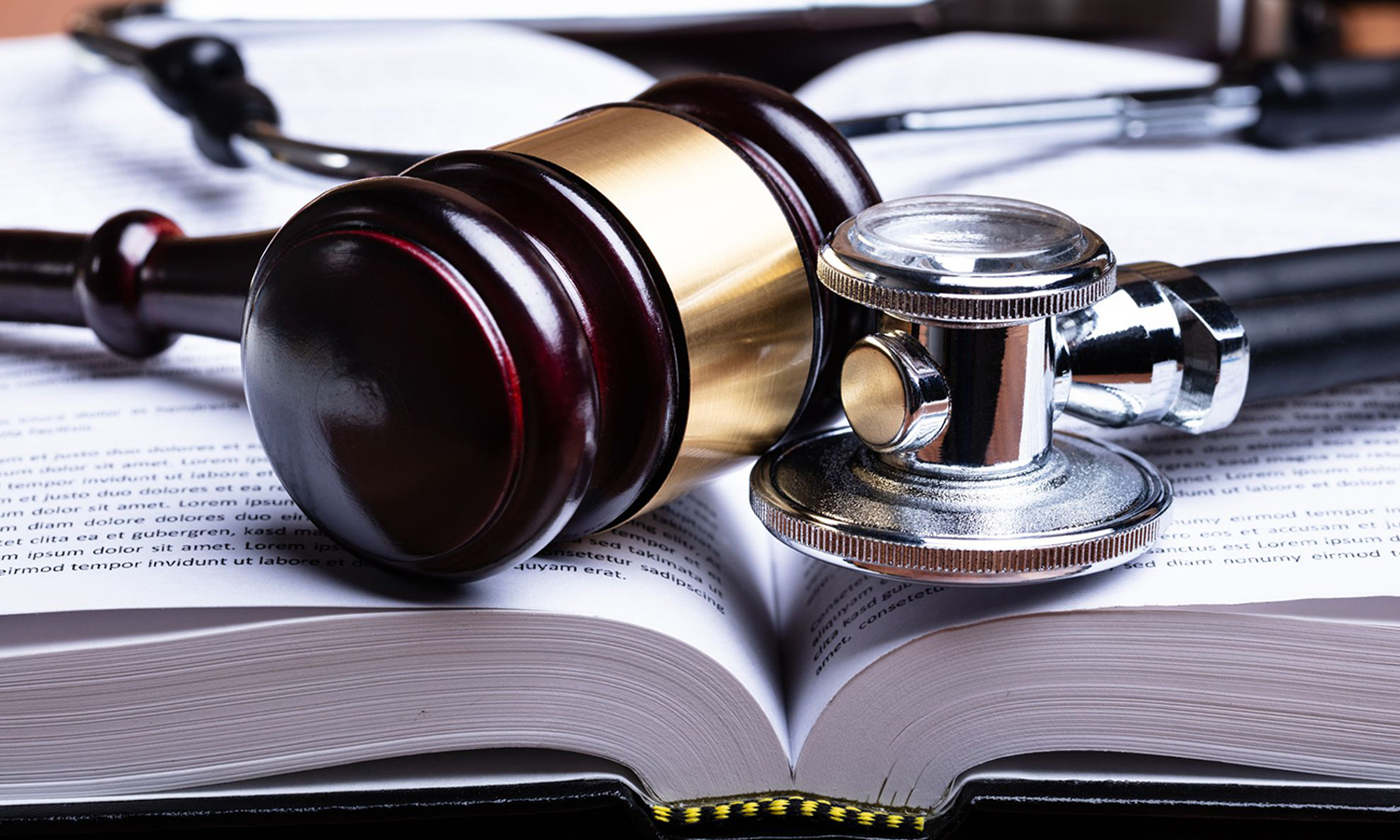 Why do doctors need to be updated with medical negligence laws?